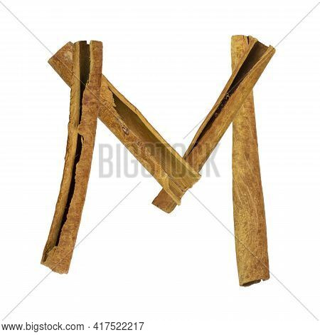Cinnamon Font. Letter M Is Made From Pieces Of Cinnamon On White Isolated. Alphabet Letters Font Set