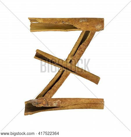 Cinnamon Font. Letter Z Is Made From Pieces Of Cinnamon On White Isolated. Alphabet Letters Font Set