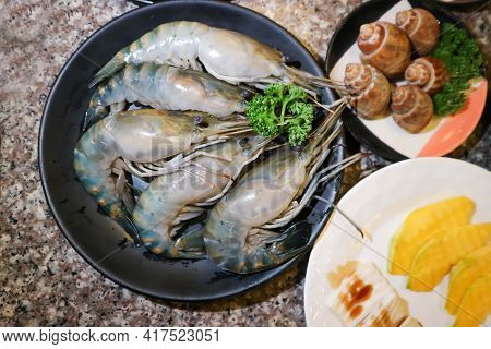 Raw Prawn, Raw Shrimp And Spotted Babylon Or Babylonia Areolata Or Shell For Cook