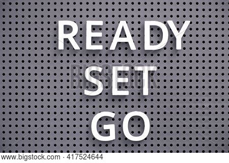 Words Ready, Set, Go Spelled Out With White Letters On Gray Pegboard. Close-up