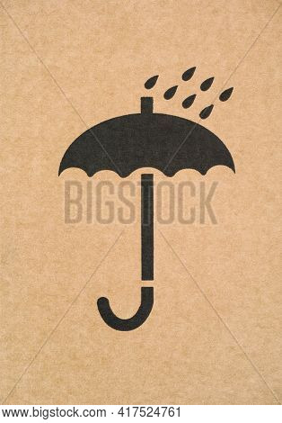 Umbrella Symbol On Cardboard. Fragile Or Packaging Symbol. Close-up