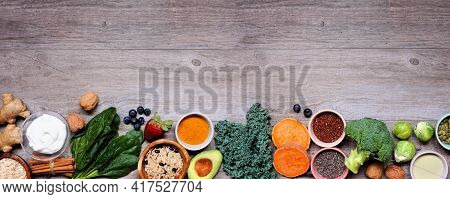Set Of Healthy Food Ingredients. Top View Bottom Border On A Wood Banner Background. Copy Space. Sup