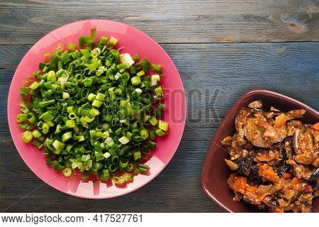 Vegetarian Food.  Onion  On Pink Plate With Vegetarian Salad On Gey Blue Wooden Background.  Healthy