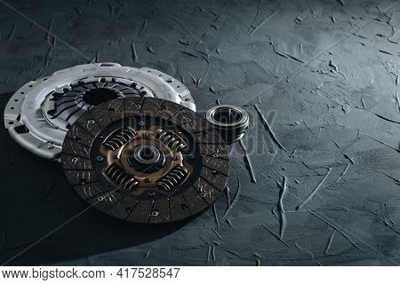 Automotive Clutch Mechanism, Disc, Basket And Bearing For Auto On A Black Background. Car Parts. Clo