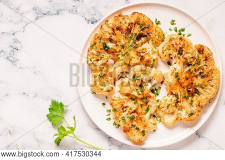Cauliflower Steak With Spices Cooked In The Oven, Top View.