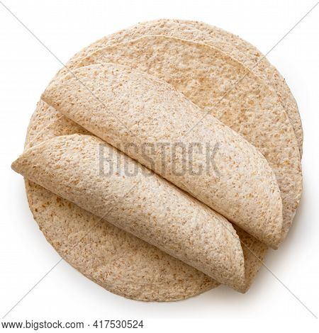 Two Rolled Up Tortillas On Top Of A Stack Of Plain Spelt And Oat Tortilla Wraps Isolated On White. T
