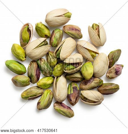 Pile Of Shelled Pistachios And Pistachios In Shell Isolated On White. Top View.