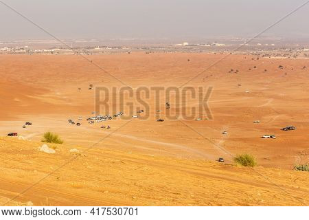 Many 4x4 Cars Parked In The Desert Before Dune Bashing Safari In Fossil Rock Area, Sharjah, Uae.