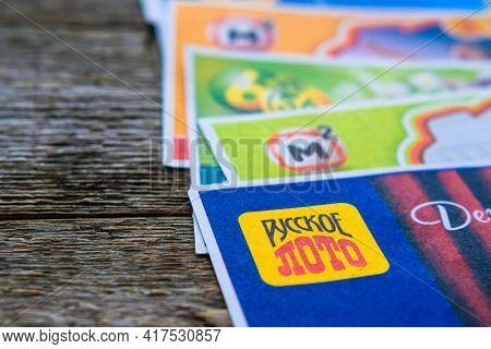 Krasnodar, Russia, April 10, 2021: Various Russia Lottery Tickets On Wooden Background. Russian Lott