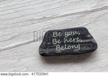 Be Here, Be You, Belong Symbol. Beautiful Stone With Words 'be Here, Be You, Belong' On Beautiful Wh