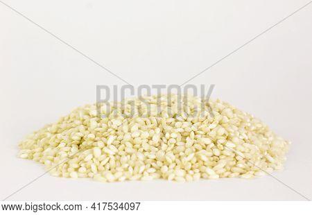 Uncooked Arborio Rice. Risotto Rice On White Background. Pile Of Arborio Short Grain White Rice Isol