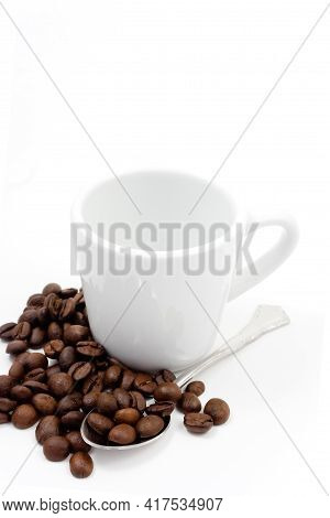 Coffe Beans With A Cup And Spoon On White Background