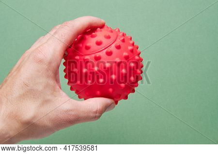 In A Mans Hand A Ball For Working Out Trigger Points Or A Physiotherapy Ball For Reflexology. Physio