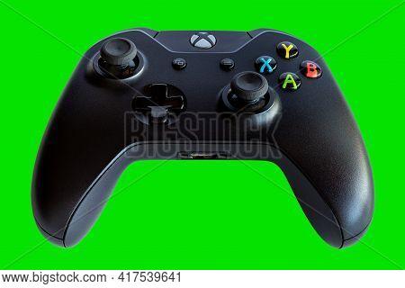 Rio De Janeiro, Brazil - April 19, 2021: Xbox Video Game Controller A Microsoft Gamepad. Green Backg