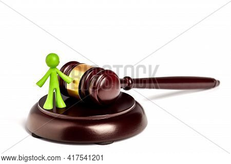 . Toy Plastic Men Isolated On White Background. The Arbitrator Examines A Conflict Situation Between