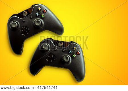 Rio De Janeiro, Brazil - April 19, 2021: Xbox Video Game Controller A Microsoft Gamepad. Orange Back
