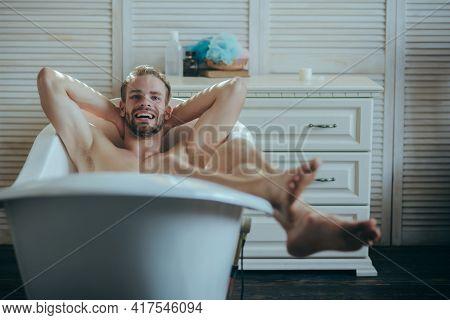 Man Having Joyful Morning In Bathtub. Smiling Gay In Bath Tub.