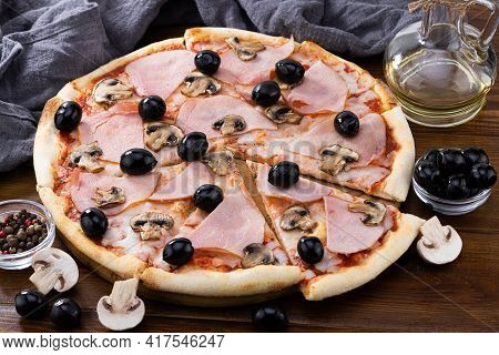 Pizza And Pizza Ingredients. Olives, Mushrooms And Pizza On A Dark Background.