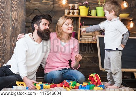 Kid With Parents Play With Build Construction. Parents Hugs, Watching Son Playing, Enjoy Parenthood.