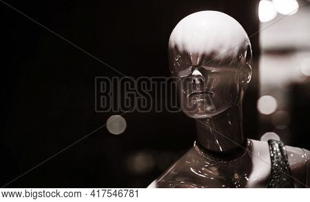 Mannequin On Balck Background. White Mannequin Shining In Fashion Shop, Defocused. Fashion And Style