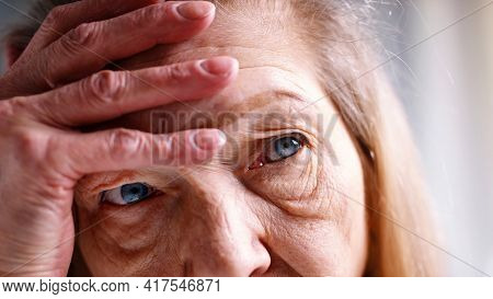 Portrait Of Lonely Old Woman Thinking About Life. High Quality Photo