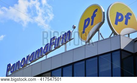 Warsaw, Poland. 19 April 2021. Sign Panorama Firm. Company Signboard Panorama Firm.