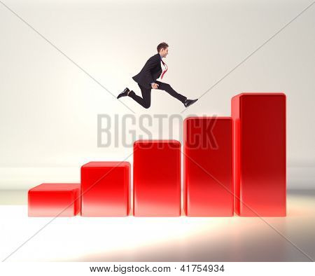 winning business man jumping o top of a 3d graph