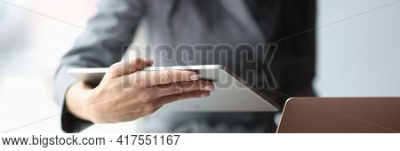 Business Woman Holding Digital Tablet And Laptop In Hands In Office Closeup