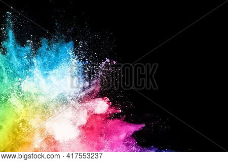 Abstract Colored Dust Explosion On A Black Background.abstract Powder Splatted Background,freeze Mot
