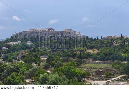 View Of The Acropolis Of Athens And Ancient Greek Ruins, Famous Tourist Attraction In Greece, In Sun