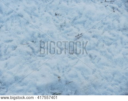 Background: White And Blue Snow With Footprints
