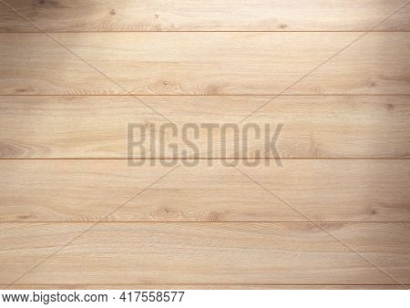 Laminate floor background texture. Wooden table top or wood laminate floor with copy space