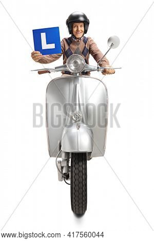 Elderly man riding a scooter and holding a learner plate isolated on white background
