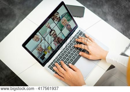 Online business conference screen in hands new normal