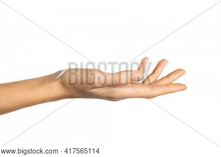 Close up of a woman hand isolated on white background. Detail of female hand with palm up receiving or holding something. Side view of open palm showing something isolated over white background.