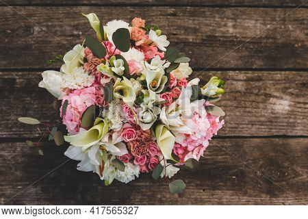 Flowers on wooden table with text space top view