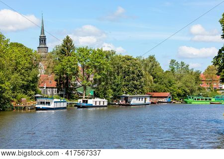 Burggraben at Stade with houseboats, Belltower of St. Cosmae church in background