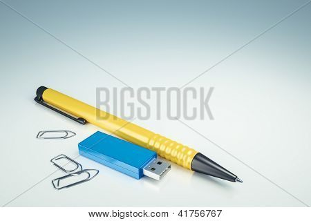 An image of a usb drive and a ballpen