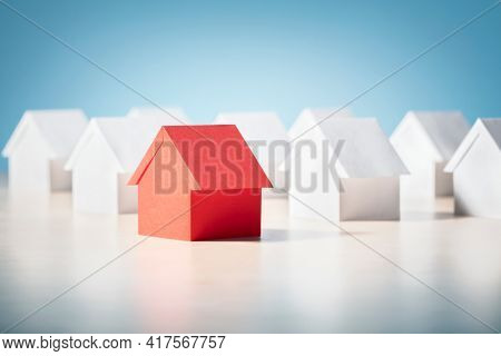 Searching for real estate property, house or new home, red paper house standing out