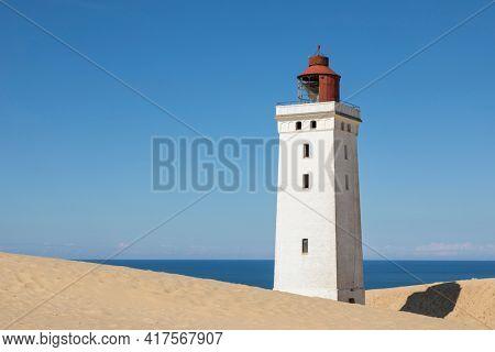 Rubjerg Knude Fyr, lighthouse on the dune near Lønstrup, Denmark, on a sunny summer day