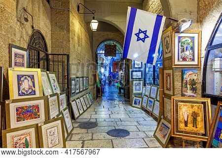 JERUSALEM, ISRAEL - JULY 16, 2015: Traditional judaica paintings for sale inside the art galley in the Old City of Jerusalem - famous and popular tourist travel destination and place to visit.