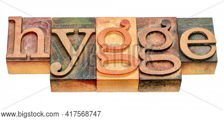 hygge - isolated word abstract in vintage letterpress wood type blocks stained by color inks, Danish cozy lifestyle concept