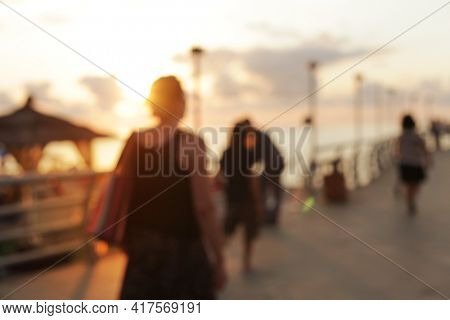 Blur Abstract tropical seafront light blur blinking background. Soft focus.