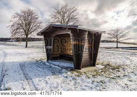 Rural Calm Winter Scenic With Brown Wooden Shelter In Hesse Germany