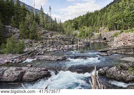 Wild Avalanche Creek Cascade In Glaciers National Park