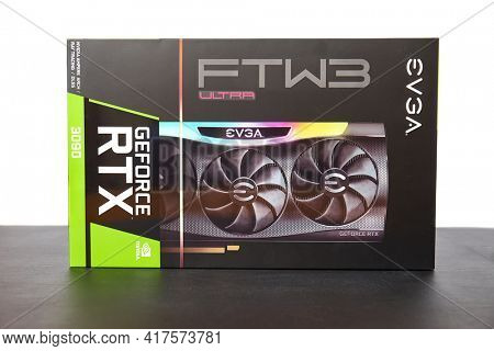 Budapest, Hungary - Circa 2020: Nvidia Geforce RTX 3090 Graphics Card made by EVGA in its box. High end GPU of the Nvidia RTX 30 series Ampere architecture for powerful gaming rigs
