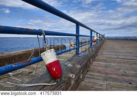 Red And White Fender Tied To Blue Metal Rail At Quai In Port Angeles