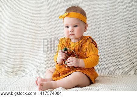 Little Cute Baby Girl Playing With Teething Beads