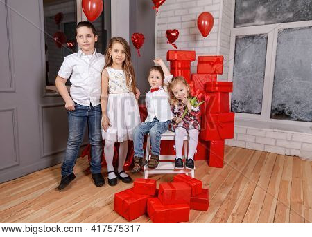 Portrait Of Happy Kids Looking At Camera. Four Cute Kids. Beautiful Children Together Indoor. Smilin