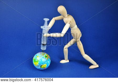 A Syringe Injecting A Vaccine Onto The Planet Earth.